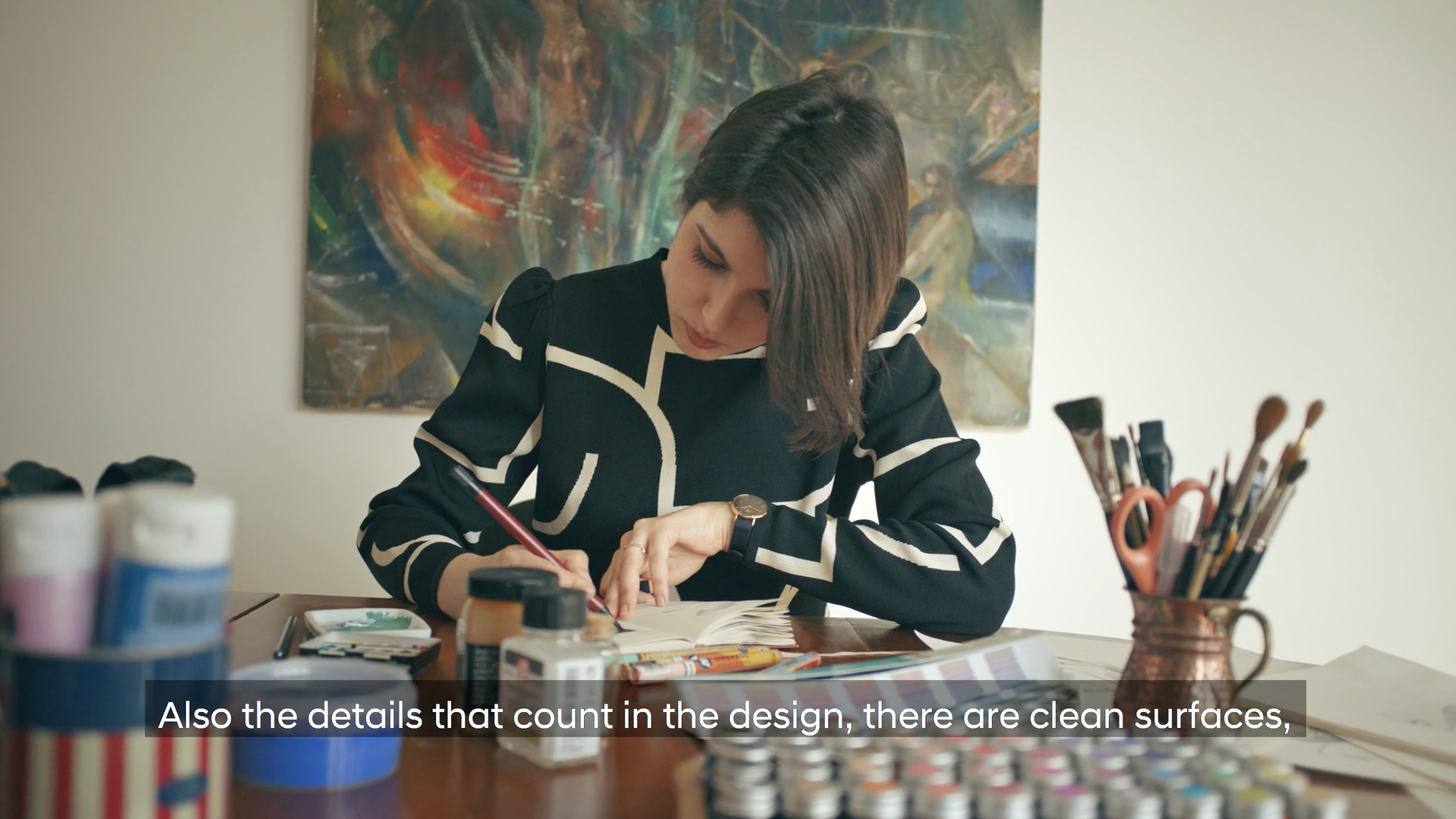 Huyndai Bayon Portrait of artist and illustrator Bahar. Drawing illustrations in her workspace